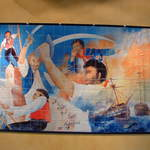 Hand painted tile depicting that pirates and sailors favored Bacardi rum